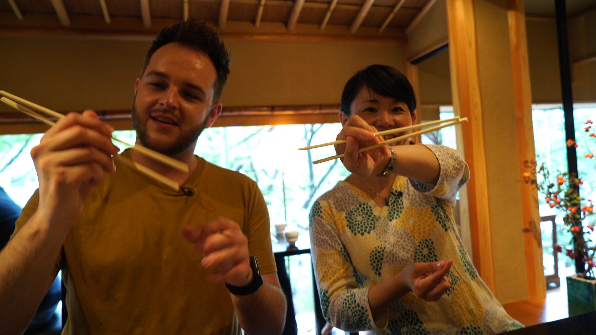 Dan learning to use chopsticks in Tokyo