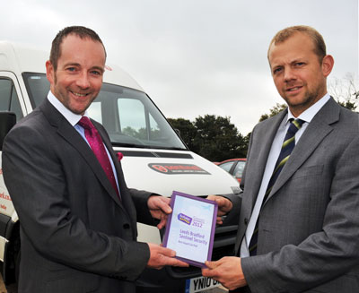 Jason Hindle Head of Commercial for Holiday Extras presents the award to Ed Hayes MD
