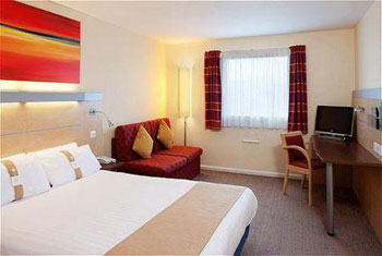 A bedroom at the Holiday Inn Express Cardiff airport.