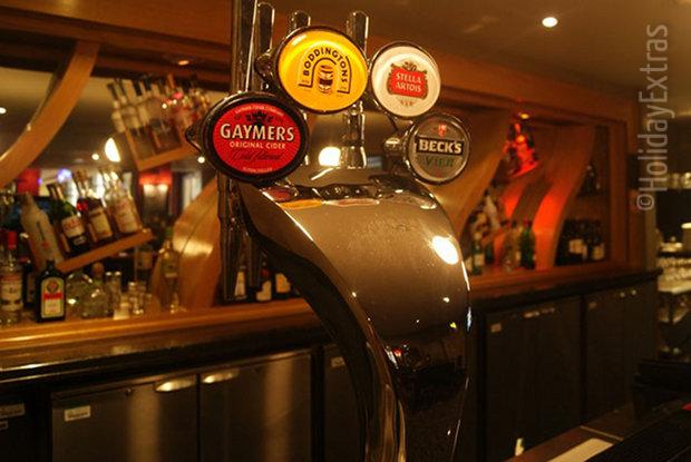 Draft beer on tap at Charlie Fry's sports bar in the Gatwick Hilton