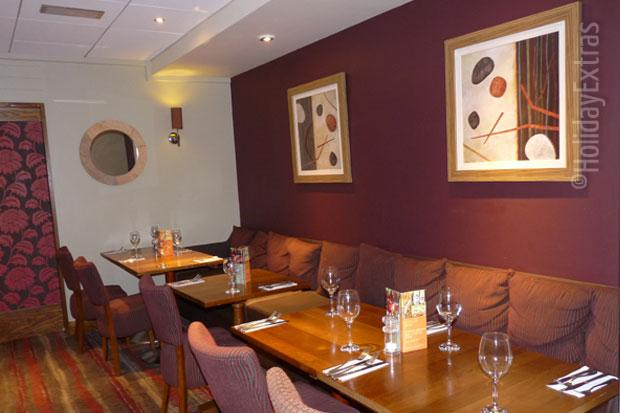 Seating in the restaurant at the Premier Inn Heathrow