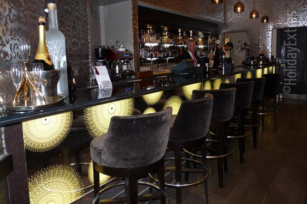 Have a seat at the bar at the Radisson Blu Edwardian Heathrow