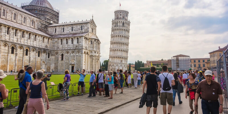 Tourists in front of the Tower of Pisa