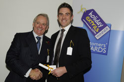 Gerry Pack presents Steve Hodgetts of 51 Degrees, Cardiff with the runner up award for best airport lounge