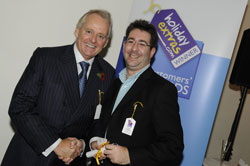 Gerry Pack presents Paul Charles of Virgin Atlantic with the award for best airline