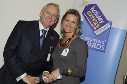 Gerry Pack presents Lynden Bulger of British Airways with the runner up award for best airline