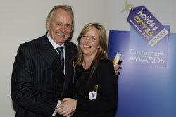 Gerry Pack presents Zita Flanagan of Aer Lingus with the award for most recommended airline for travelling with babies