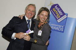 Gerry Pack presents Lynden Bulger of British Airways with the runner up award for most recommended airline for travelling with babies