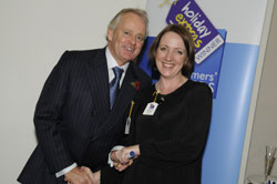 Gerry Pack presents Anne Marie Cottee of Monarch with the runner up award for best cabin crew