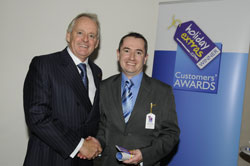 Gerry Pack presents Ian Smith of Liverpool John Lennon Airport with the award for best airport