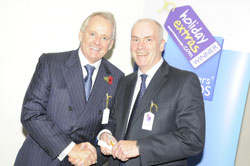 Gerry Pack presents Nick Campbell of the Crowne Plaza Heathrow with the award for best airport hotel