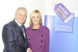 Gerry Pack presents Katherine Gordon of the Sheraton Heathrow with the runner up award for best airport hotel