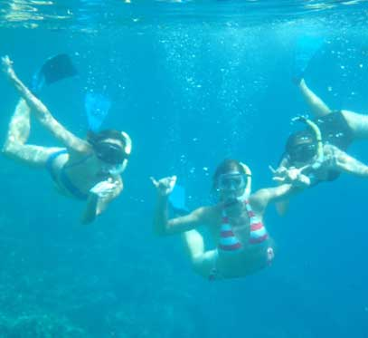 Girls snorkeling in Hawaii