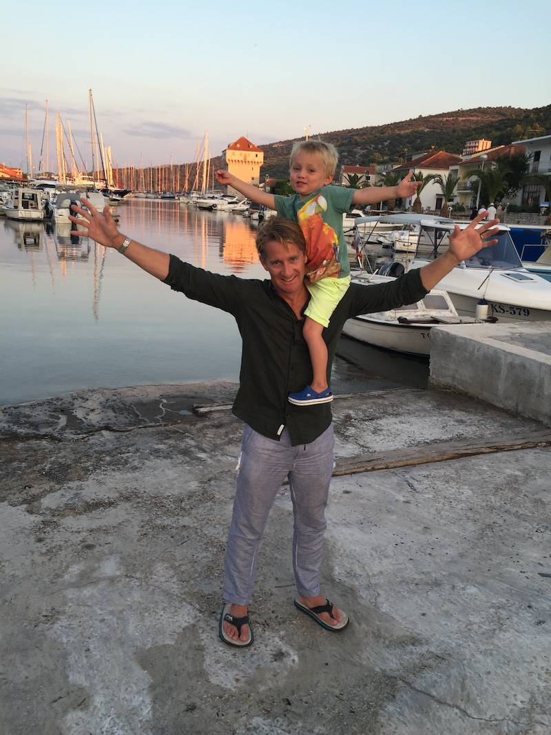 Matthew Pack CEO Holiday Extras with son Henry on his shoulders whilst on holiday in Croatia